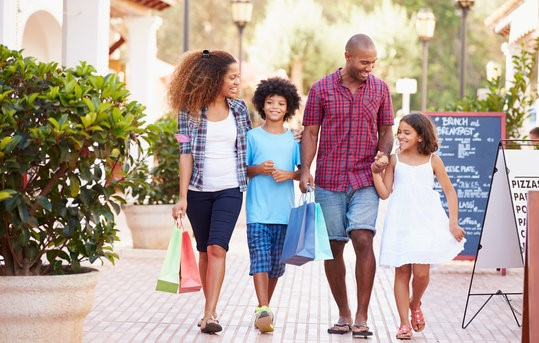 Happy Family Shopping together in the summer