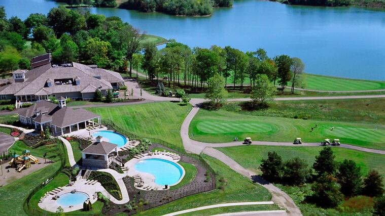 Overhead photo of community with amenities including three pools, open air cabana, clubhouse, and golf course